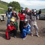 teens dressed in go kart uniforms